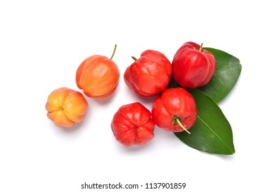 Flat lay of colorful Acerola cherry with green leaves on white background, Top view