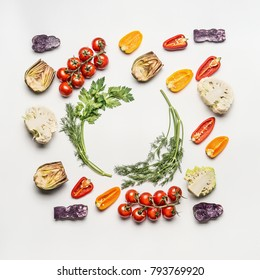 Flat lay of colorful salad vegetables ingredients with seasoning on white background, top view, frame.  Healthy clean eating layout, vegetarian food and diet nutrition concept