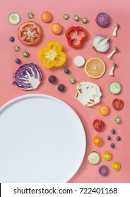 Flat lay colourful assorted vegan food on pink background. Empty plate text space image.