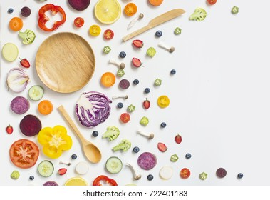 Flat lay colourful assorted vegan food slice on white background. Empty plate text space image.