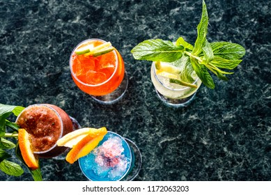 Flat lay of colourful cocktails on a table.