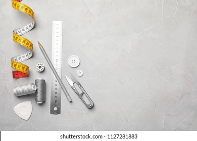 Flat lay composition with accessories for tailoring on table