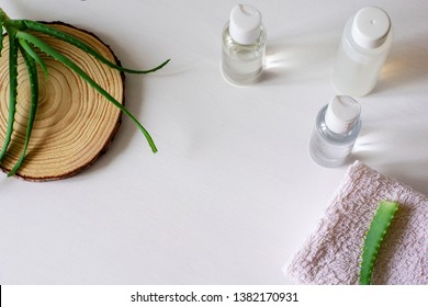 Flat lay composition with aloe vera on white background.