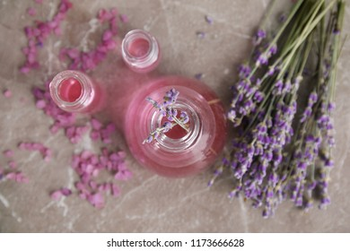 Flat lay composition with aromatic lavender oil on grey background