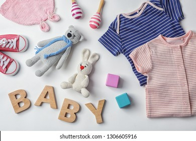 Flat lay composition with baby clothes and accessories on white background