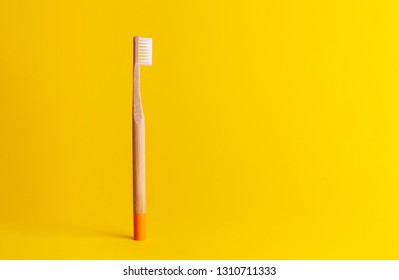 Flat lay composition with bamboo toothbrush space for text on color background