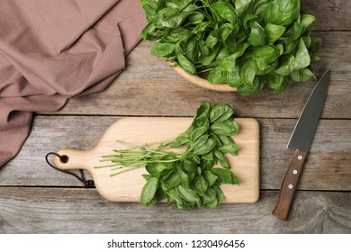 Flat lay composition with basil leaves on wooden table