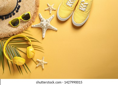 Flat lay composition with beach accessories on color background. Space for text
