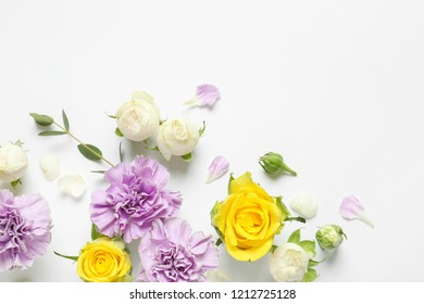 Flat lay composition with beautiful blooming flowers on white background