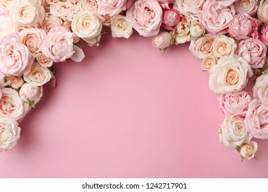 Flat lay composition with beautiful roses and space for text on color background
