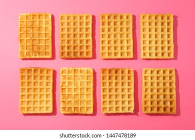 Flat lay composition with belgian waffles on color background
