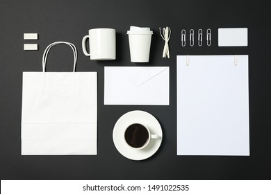 Flat lay composition with blank stationery on black background, copy space