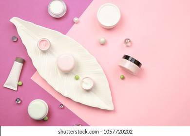 Flat lay composition with body care cosmetics on color background