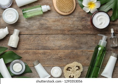 Flat lay composition with body care products and space for text on wooden background