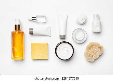 Flat lay composition with body care products on white background