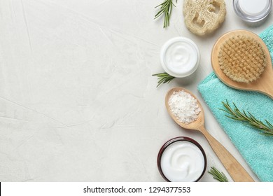 Flat lay composition with body care products and space for text on light background