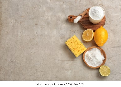 Flat lay composition with bowls of baking soda and space for text on gray table