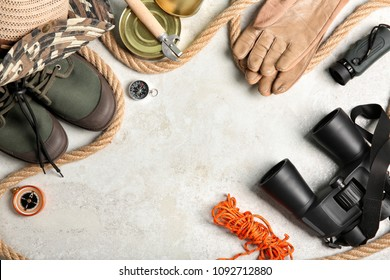Flat lay composition with camping equipment on light background