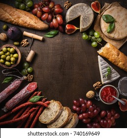 Flat lay composition with cheese, meat and fruits