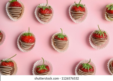 Flat lay composition with chocolate covered strawberries on color background