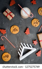 Flat lay composition with Christmas cookies, decor  and cocoa on the black table