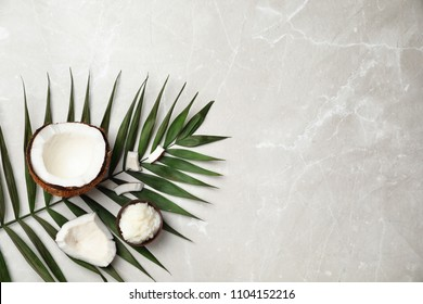 Flat lay composition with coconut oil on grey background. Healthy cooking