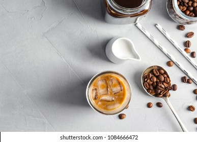 Flat lay composition with cold brew coffee and milk on grey background