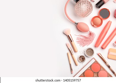 Flat lay composition with coral accessories on white background. Space for text