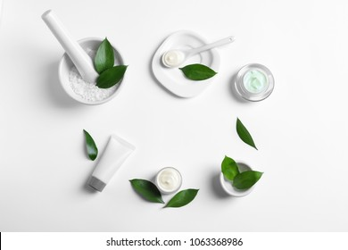 Flat lay composition with cosmetic products on white background