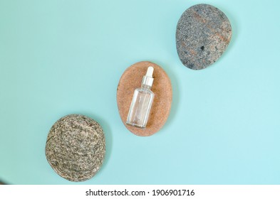 Flat lay composition with cosmetic products on color background. Organic sponges, sea stones