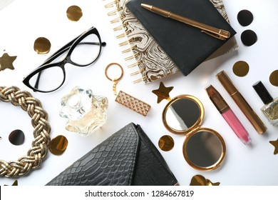 Flat lay composition with cosmetics and accessories on white background
