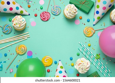 Flat lay composition with cupcakes on light green background, space for text. Birthday party