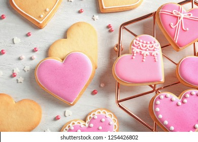 Flat lay composition with decorated heart shaped cookies on table