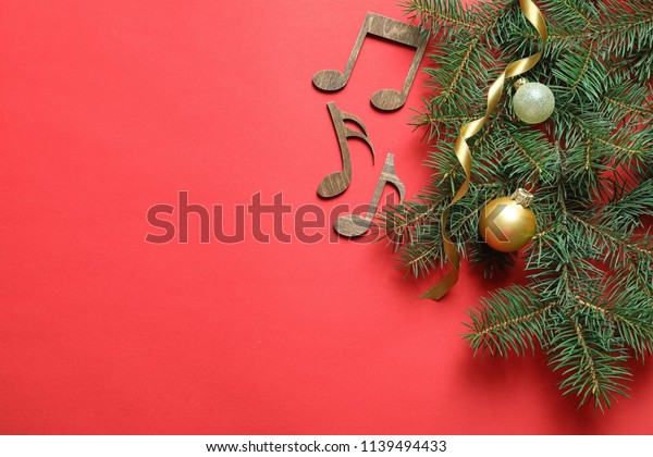 Flat lay composition with decorations and  notes on color background. Christmas music concept
