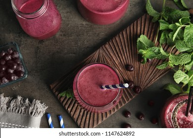 Flat lay composition with delicious acai juice on dark table