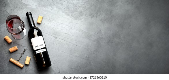 Flat lay composition with delicious red wine on grey table, space for text. Banner design - Shutterstock ID 1726360210