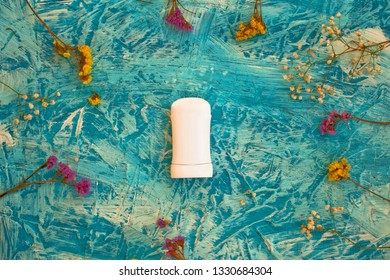 Flat lay composition with deodorant and herbs on colorful background