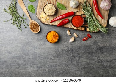 Flat lay composition with different aromatic spices and space for text on table