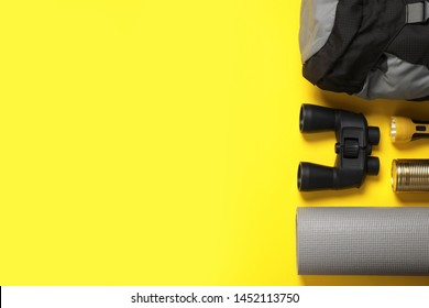 Flat lay composition with different camping equipment on color background, space for text