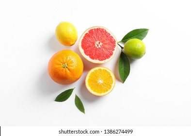 Flat lay composition with different citrus fruits on white background - Shutterstock ID 1386274499