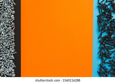 Flat Lay Composition With Different Screws on Black, Orange and Blue Background. Top View of Checklist Concept