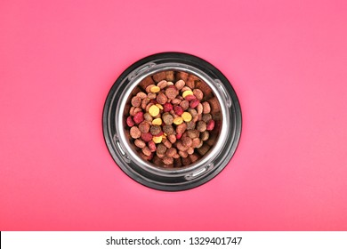 Flat lay composition with dry pet food  on red background. Top view.