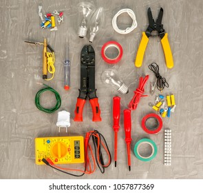 Flat lay composition with electrical tools on grey background