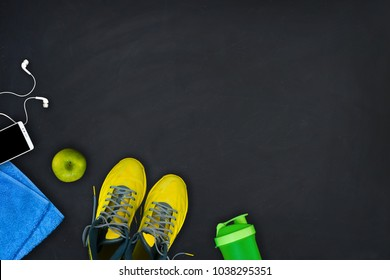Flat lay composition of fitness equipment on a black background. Concept of healthy lifestyle, sport, yoga and diet.