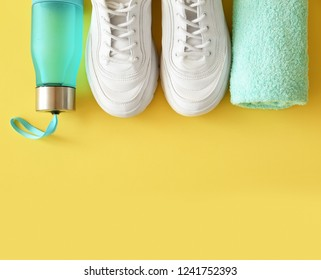Flat lay composition with fitness equipment and space for text on color background