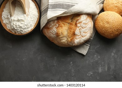 Flat lay composition with fresh bread and space for text on grey table