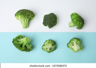 Flat lay composition with fresh green broccoli on color background