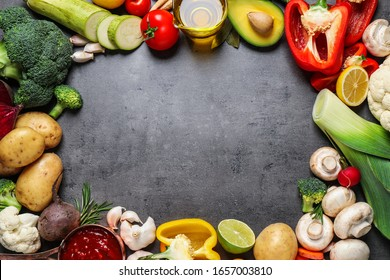 Flat lay composition with fresh products on grey table, space for text. Healthy cooking
