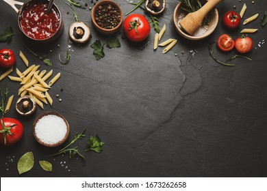 Flat lay composition with fresh products on black table, space for text. Healthy cooking