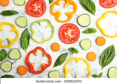 Flat lay composition with fresh salad ingredients on white marble table